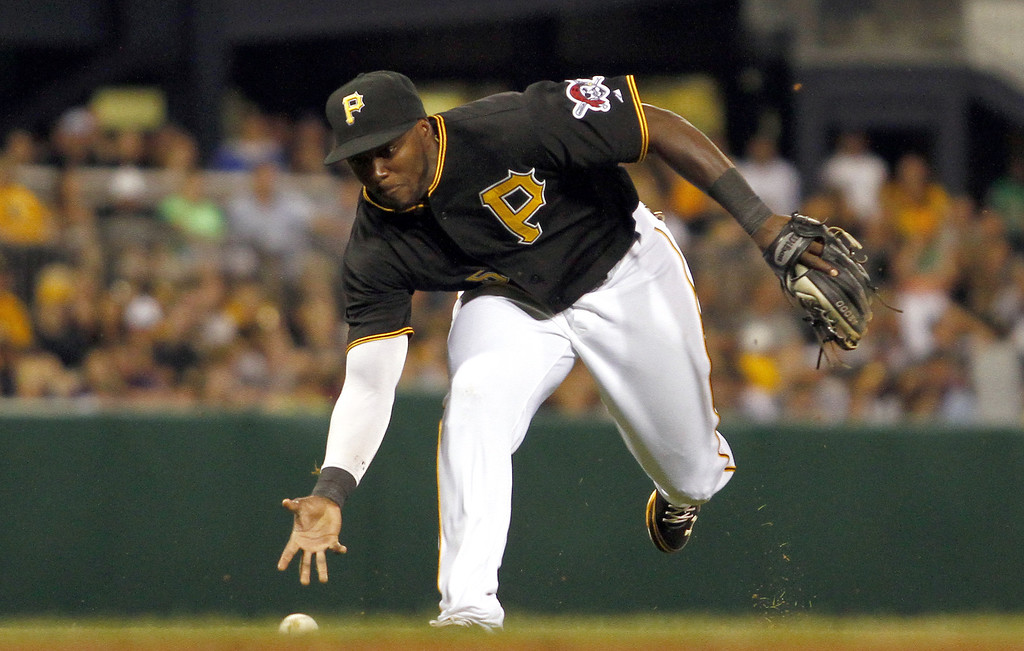 . PITTSBURGH, PA - AUGUST 03:  Josh Harrison #5 of the Pittsburgh Pirates bare hands a ground ball in the eighth inning against the Colorado Rockies during the game on August 3, 2013 at PNC Park in Pittsburgh, Pennsylvania.  (Photo by Justin K. Aller/Getty Images)