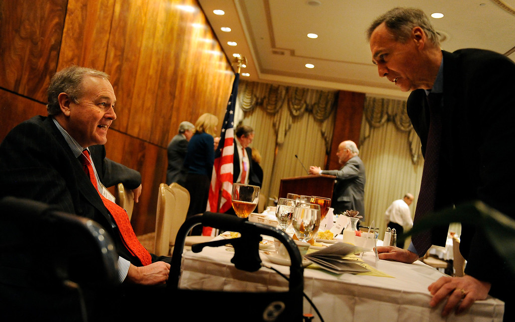 . William Dean Singleton, CEO of MediaNews Group, Inc., and Chairman of The Associated Press Board talks with Tom Curley, President of the Associated Press, right, following a luncheon sponsored by the Colorado Press Association, in Denver, CO.  Craig F. Walker/The Denver Post.