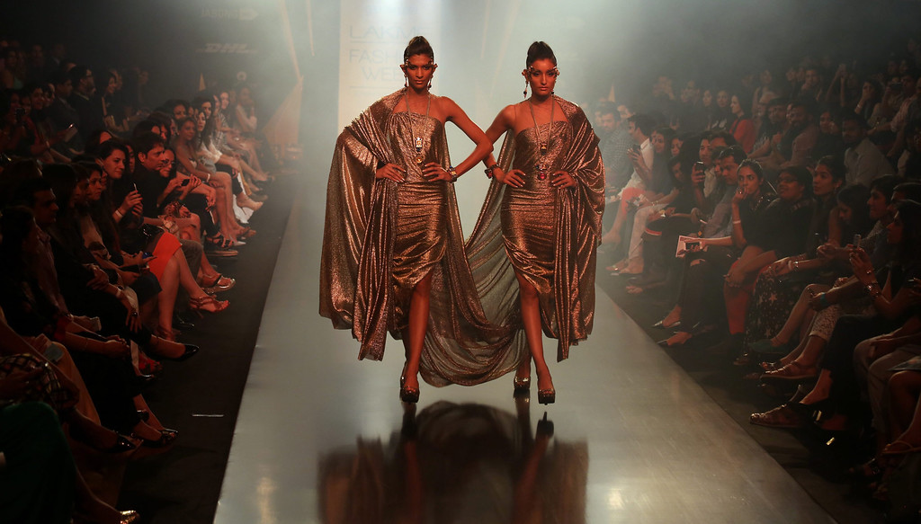 . Models present creations by Mawi and Gaurav Gupta during the Lakme Fashion Week Summer/Resort 2014 in Mumbai, India, 13 March 2014. Some 92 designers will be showcasing their collections at the event from 12 to 16 March.  EPA/DIVYAKANT SOLANKI