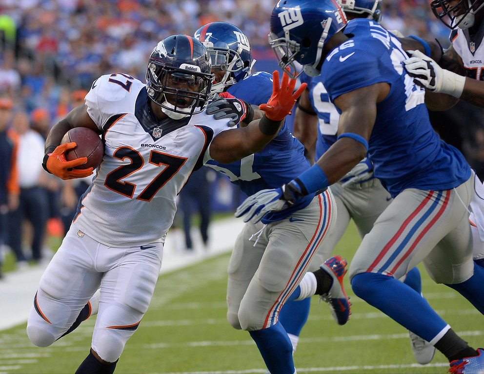 . Running back Knowshon Moreno (27) of the Denver Broncos bullies his way into the endzone to make the score 6-3 in the second quarter vs the New York Giants at METLIFE Stadium. September 15, 2013 East Rutherford, NJ. (Photo By Joe Amon/The Denver Post)