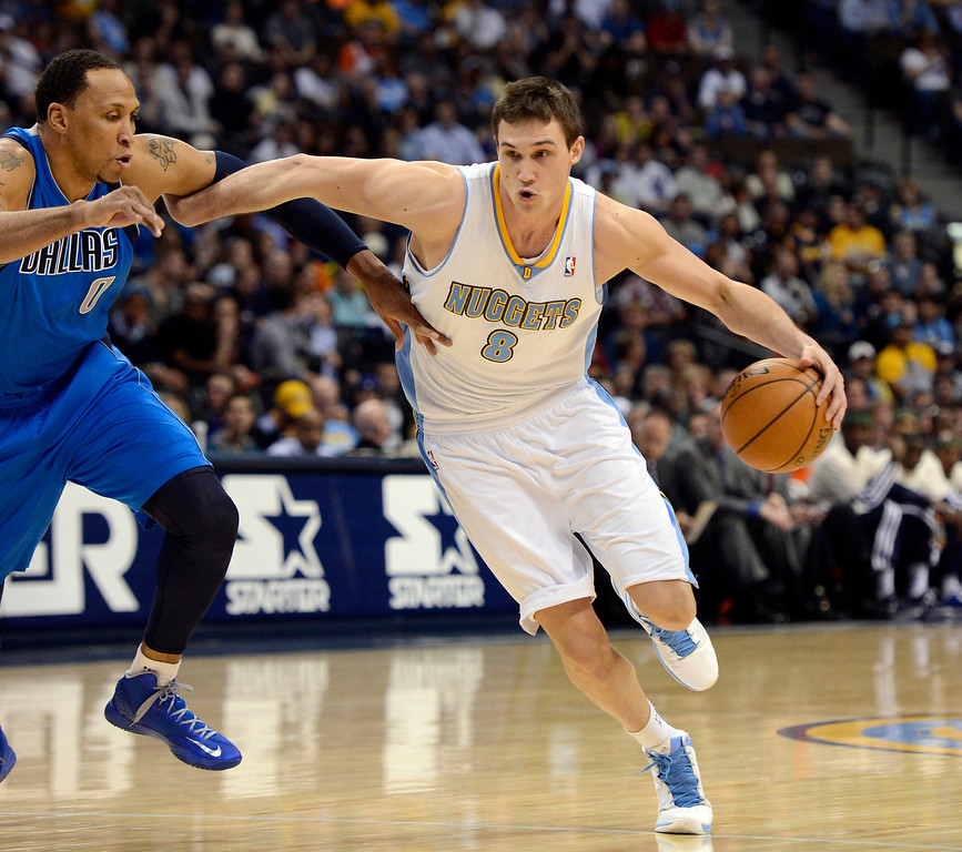 . DENVER, CO. - APRIL 04: Danilo Gallinari (8) of the Denver Nuggets drives on Shawn Marion (0) of the Dallas Mavericks during the first quarter April 4,  2013 at Pepsi Center. (Photo By John Leyba/The Denver Post)