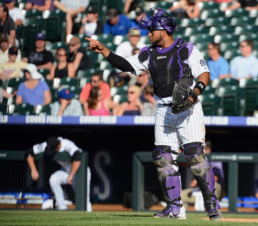 . Catcher Willin Rasario #20 of the Colorado Rockies gestures to the pitcher during a game against the New York Mets at Coors Field on June 27, 2013 in Denver, Colorado. Photo by Garrett W. Ellwood/Getty Images)