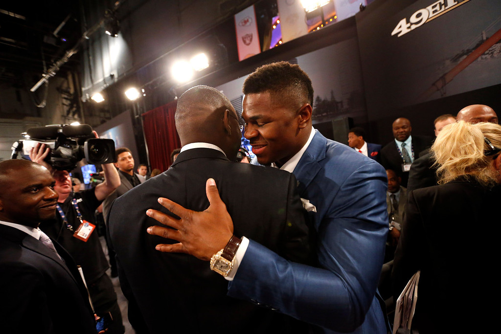 . Khalil Mack, right, from Buffalo, is congratulated after being selected fifth overall in the first round of the NFL football draft by the Oakland Raiders, Thursday, May 8, 2014, at Radio City Music Hall in New York. (AP Photo/Jason DeCrow)