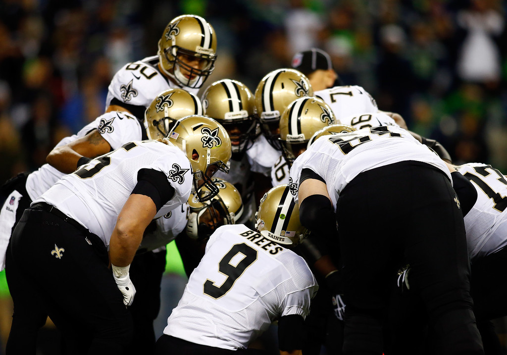 . Quarterback Drew Brees #9 of the New Orleans Saints calls a play in the huddle against the Seattle Seahawks during a game at CenturyLink Field on December 2, 2013 in Seattle, Washington.  (Photo by Jonathan Ferrey/Getty Images)