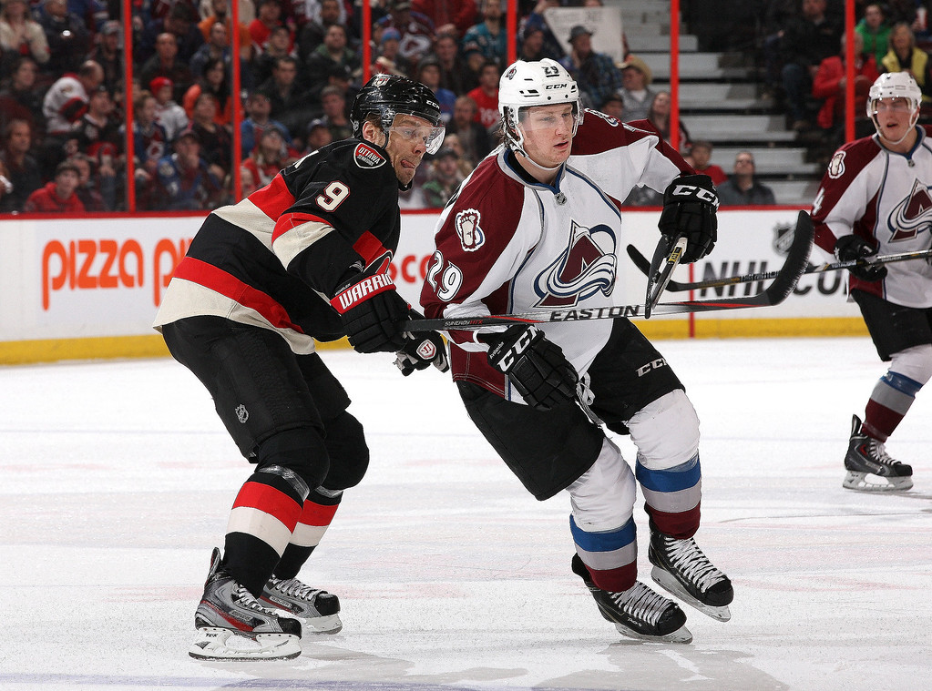 . Milan Michalek #9 of the Ottawa Senators battles for position against Nathan MacKinnon #29 of the Colorado Avalanche during an NHL game at Canadian Tire Centre on March 16, 2014 in Ottawa, Ontario, Canada.  (Photo by Jana Chytilova/Freestyle Photography/Getty Images)