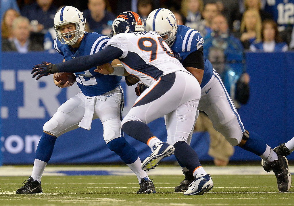 . Denver Broncos defensive end Shaun Phillips (90) sackes Indianapolis Colts quarterback Andrew Luck (12) during the first quarter October 20, 2013 at Lucas Oil Field. Photo by John Leyba/The Denver Post)