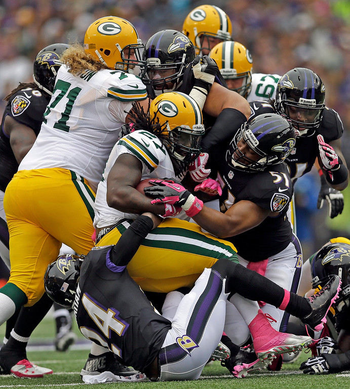 . Green Bay Packers running back Eddie Lacy (27) is brought to a sudden stop during the first half of a NFL football game against the Baltimore Ravens in Baltimore, Sunday, Oct. 13, 2013. (AP Photo/Patrick Semansky)