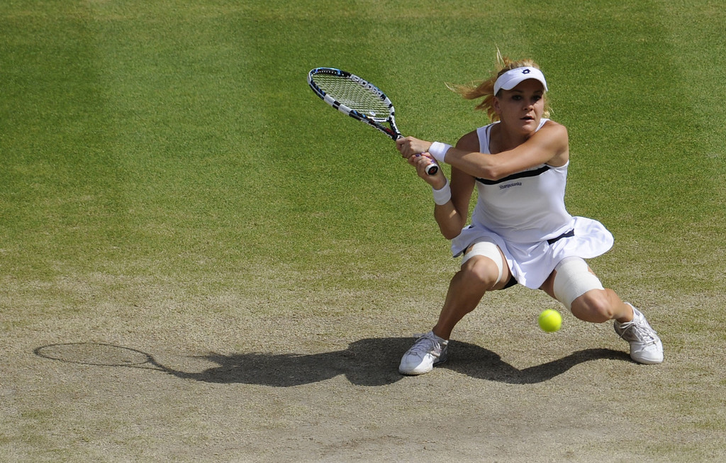 . Poland\'s Agnieszka Radwanska returns against Germany\'s Sabine Lisicki in their women\'s singles semi-final match on day ten of the 2013 Wimbledon Championships tennis tournament at the All England Club in Wimbledon, southwest London, on July 4, 2013. Lisicki won 6-4, 2-6, 9-7.  TOM HEVEZI/AFP/Getty Images