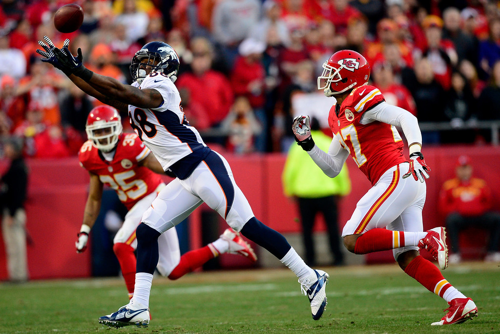 . Demaryius Thomas (88) of the Denver Broncos cannot make a catch as Sean Smith (27) of the Kansas City Chiefs defends during the first half of the Broncos\' 35-28 win at Arrowhead Stadium. The Denver Broncos visit the Kansas City Chiefs in an AFC West showdown. (Photo by AAron Ontiveroz/The Denver Post)