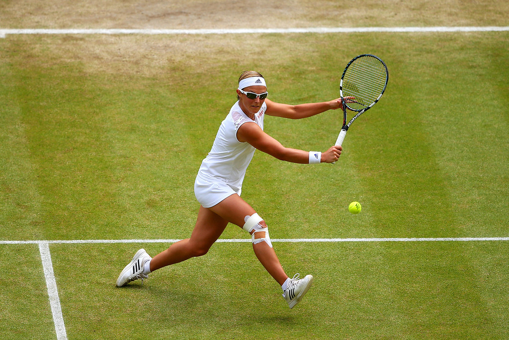 . LONDON, ENGLAND - JULY 04:  Kirsten Flipkens of Belgium hits a backhand match against Marion Bartoli of France on day ten of the Wimbledon Lawn Tennis Championships at the All England Lawn Tennis and Croquet Club on July 4, 2013 in London, England.  (Photo by Julian Finney/Getty Images)