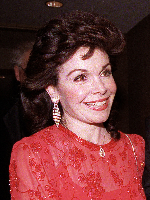 . In this Oct. 20, 1990 file photo, actress and former Mickey Mouse Club member Annette Funicello arrives for the 15th annual Italian American Foundation dinner in Washington, D.C.  (AP Photo/J. Scott Applewhite, file)