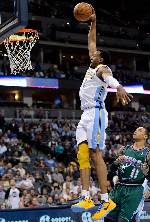 . DENVER, CO. - FEBRUARY 05: Andre Iguodala (9) of the Denver Nuggets flies to the basket for a dunk past Monta Ellis (11) of the Milwaukee Bucks during the first quarter February 05, 2013 at Pepsi Center. The Denver Nuggets take on the Milwaukee Bucks in NBA action. (Photo By John Leyba/The Denver Post)