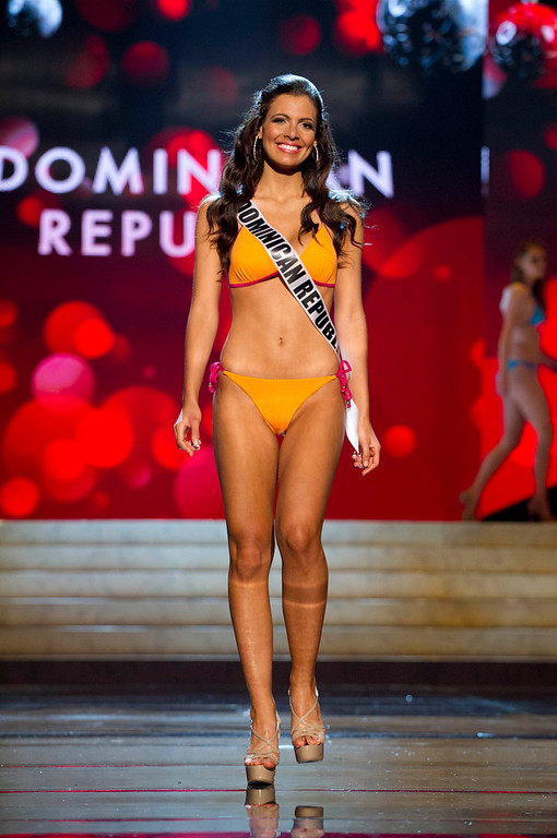 . Miss Dominican Republic Dulcita Lieggi competes in her Kooey Australia swimwear and Chinese Laundry shoes during the Swimsuit Competition of the 2012 Miss Universe Presentation Show at PH Live in Las Vegas, Nevada December 13, 2012. The 89 Miss Universe Contestants will compete for the Diamond Nexus Crown on December 19, 2012. REUTERS/Darren Decker/Miss Universe Organization/Handout