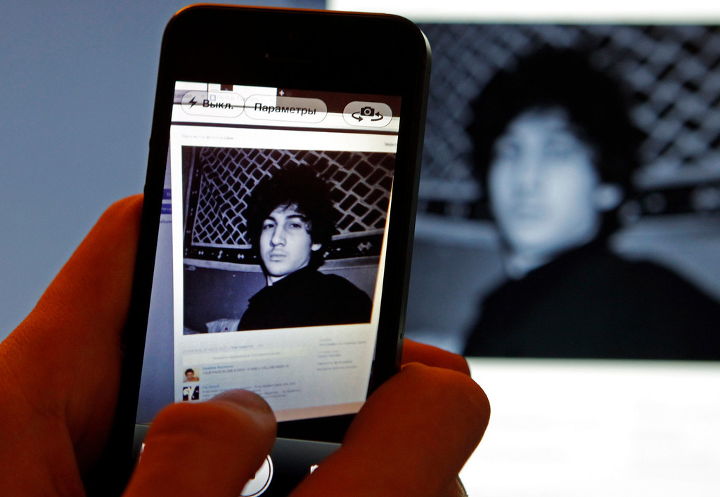 . A photograph of Djohar Tsarnaev, who is believed to be Dzhokhar Tsarnaev, a suspect in the Boston Marathon bombing, is seen on his page of Russian social networking site Vkontakte (VK), as pictured on a monitor and a mobile phone in St. Petersburg April 19, 2013. Tsarnaev posted links to Islamic websites and others calling for Chechen independence on what appears to be his page on the site. Police launched a massive manhunt for Tsarnaev, 19, after killing his older brother Tamerlan Tsarnaev in a shootout overnight.        REUTERS/Alexander Demianchuk