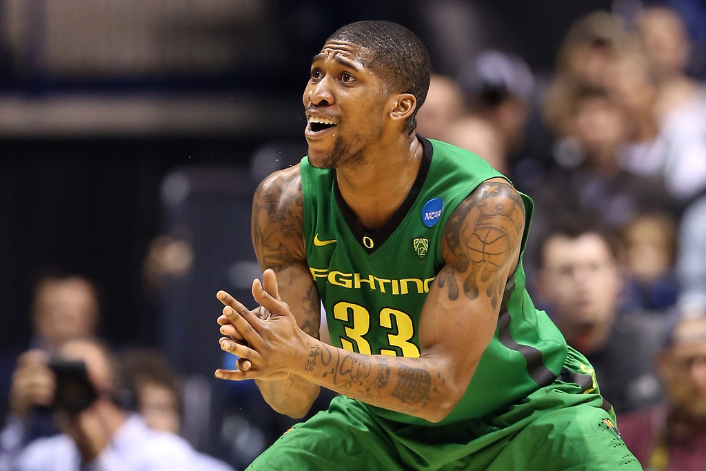 . Carlos Emory #33 of the Oregon Ducks reacts in the second half against the Louisville Cardinals during the Midwest Region Semifinal round of the 2013 NCAA Men\'s Basketball Tournament at Lucas Oil Stadium on March 29, 2013 in Indianapolis, Indiana.  (Photo by Andy Lyons/Getty Images)
