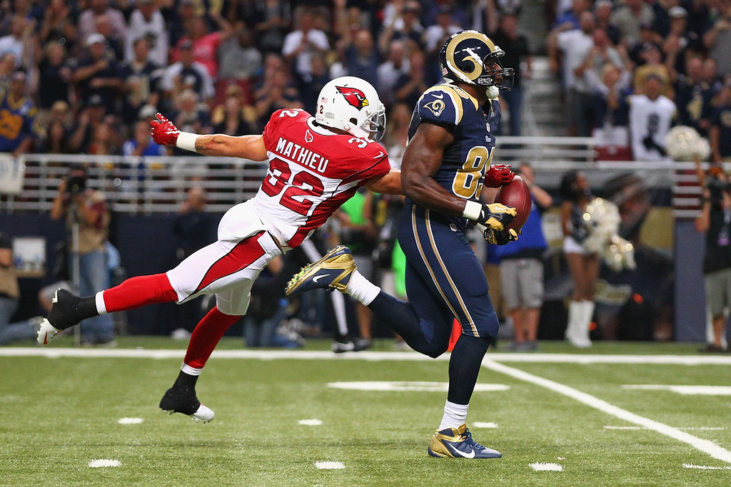 . Tyrann Mathieu #32 of the Arizona Cardinals punches the ball out of the hands of Jared Cook #89 of the St. Louis Rams to prevent a touchdown at the Edward Jones Dome on September 8, 2013 in St. Louis, Missouri.  (Photo by Dilip Vishwanat/Getty Images)
