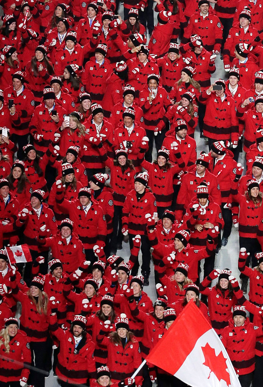 . Team Canada enters the arena during the opening ceremony of the 2014 Winter Olympics in Sochi, Russia, Friday, Feb. 7, 2014. (AP Photo/Charlie Riedel)