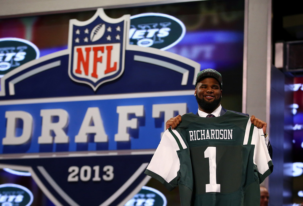 . Sheldon Richardson of the Missouri Tigers holds up a jersey on stage after he was picked #13 overall by the New York Jets in the first round of the 2013 NFL Draft at Radio City Music Hall on April 25, 2013 in New York City.  (Photo by Al Bello/Getty Images)