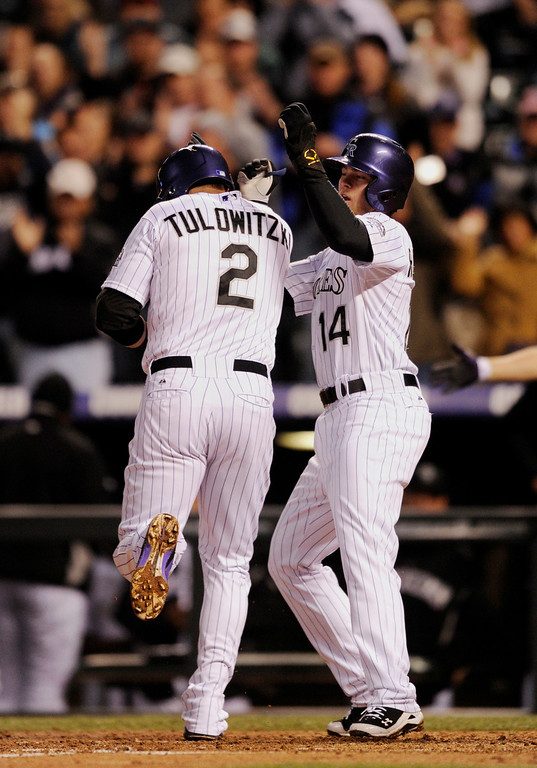 . DENVER, CO. - APRIL 19:  Teammate Josh Rutledge (14) congratulated Troy Tulowitzki (2) at the plate after he homered in the fourth inning. The Colorado rockies hosted the Arizona Diamondbacks at Coors Field Friday night, April 19, 2013.  Photo By Karl Gehring/The Denver Post)