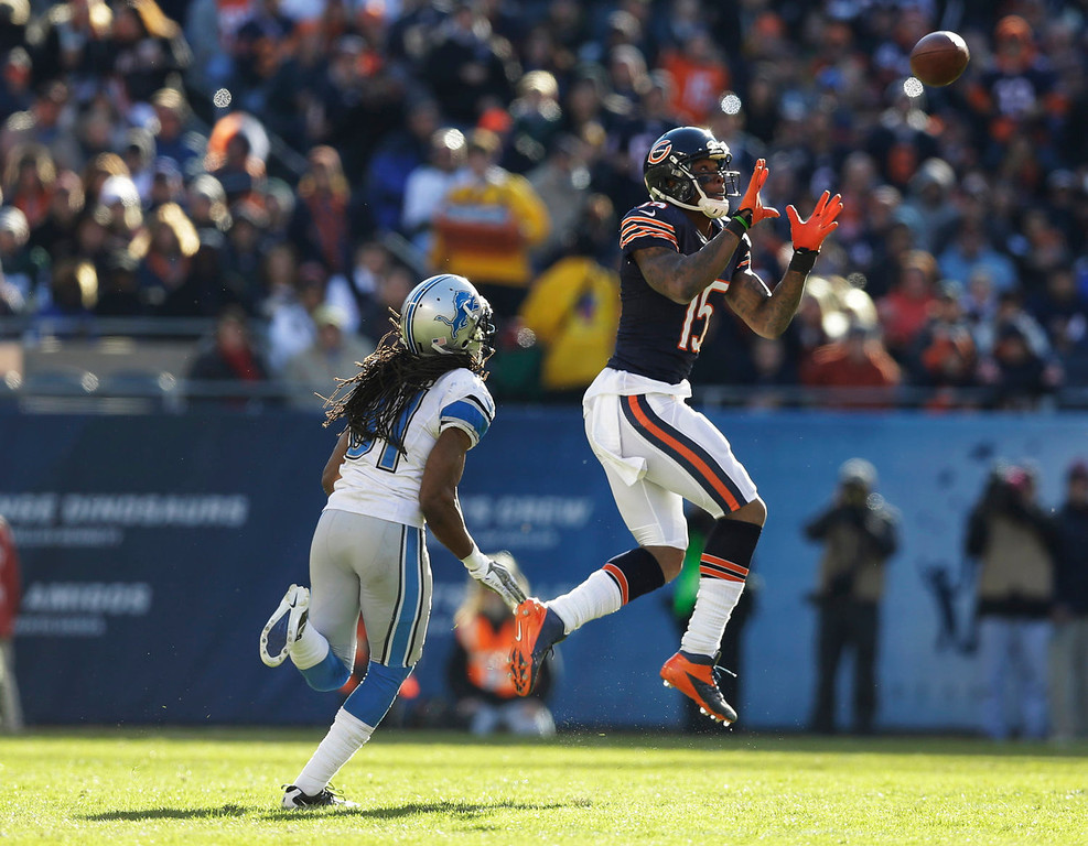 . Chicago Bears wide receiver Brandon Marshall (15) makes a catch in front of Detroit Lions cornerback Rashean Mathis (31) during the second half of an NFL football game, Sunday, Nov. 10, 2013, in Chicago. (AP Photo/Nam Y. Huh)