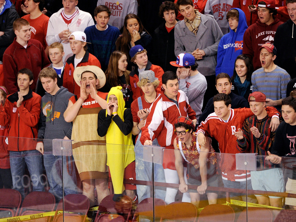 . DENVER, CO. - FEBRUARY 28: The Regis student body turned out in number and style Thursday night. Monarch High School met Regis Jesuit Thursday night, February 28, 2013 in a semifinal match in the Colorado State Ice Hockey Championships at Magness Arena in Denver.  (Photo By Karl Gehring/The Denver Post)