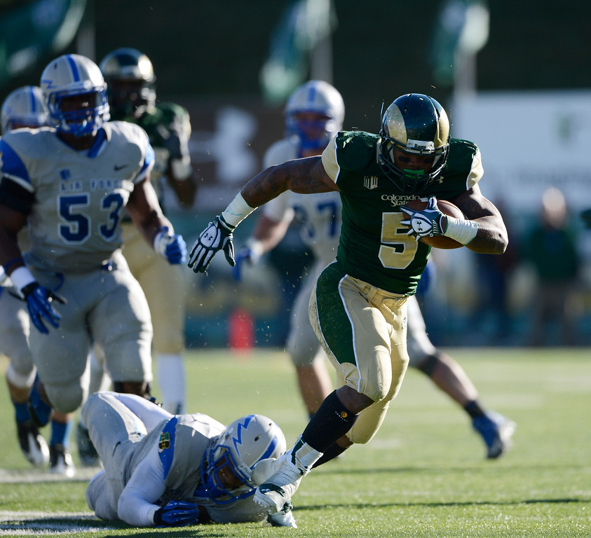 . Colorado State RB, Kapri Bibbs, gets tripped up by Air Force DB, Steffon Batts, in the third quarter at Hughes Stadium Saturday afternoon, November 30, 2013. The Rams won 58-13. (Photo By Andy Cross/The Denver Post)
