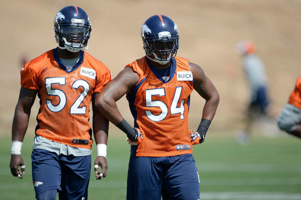 . Denver Broncos Jerrell Harris (52) and Brandon Marshall (54) look on  during OTAs June 11, 2014 at Dove Valley. (Photo by John Leyba/The Denver Post)