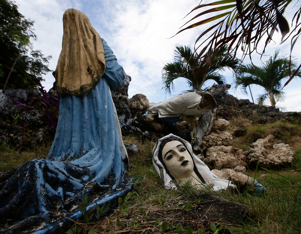 . The quake-toppled head of a Catholic figure lies on the ground at Clarin Catholic church at Clarin township, Bohol province in central Philippines Thursday Oct.17, 2013.  (AP Photo/Bullit Marquez)