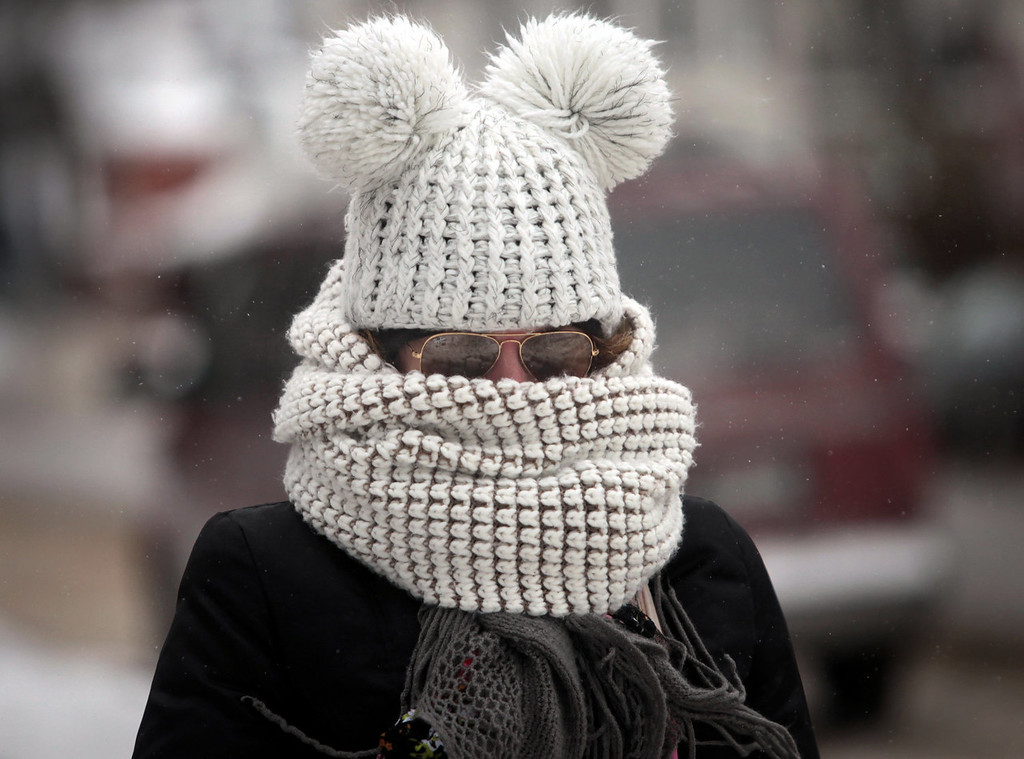 . As frigid weather takes hold on the upper Midwest, Kristy Gruley of Madison, Wis. is well-bundled against the elements while walking in the city Friday, Jan. 3, 2014. (AP Photo, John Hart, Wisconsin State Journal)