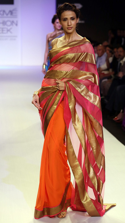. A model presents a creation by Indian designer Mandira Bedi during the Lakme Fashion Week Summer/Resort 2014 in Mumbai, India, 13 March 2014. Some 92 designers will be showcasing their collections during the event running from 12 to 16 March.  EPA/DIVYAKANT SOLANKI