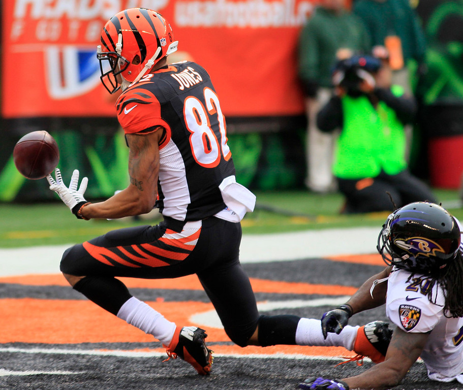 . Cincinnati Bengals wide receiver Marvin Jones (82) catches a 16-yard touchdown pass against Baltimore Ravens cornerback Lardarius Webb (21) in the first half of an NFL football game on Sunday, Dec. 29, 2013, in Cincinnati. (AP Photo/Tom Uhlman)
