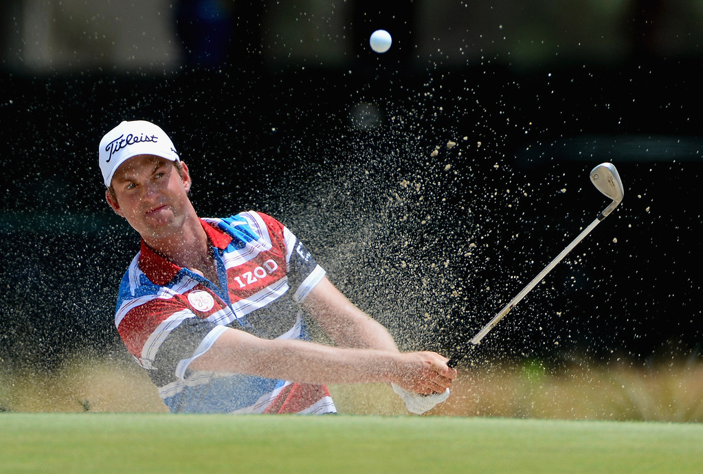 . Webb Simpson of the United States hits his second shot on the 17th hole during the first round of the 114th U.S. Open at Pinehurst Resort & Country Club, Course No. 2 on June 12, 2014 in Pinehurst, North Carolina.  (Photo by Ross Kinnaird/Getty Images)