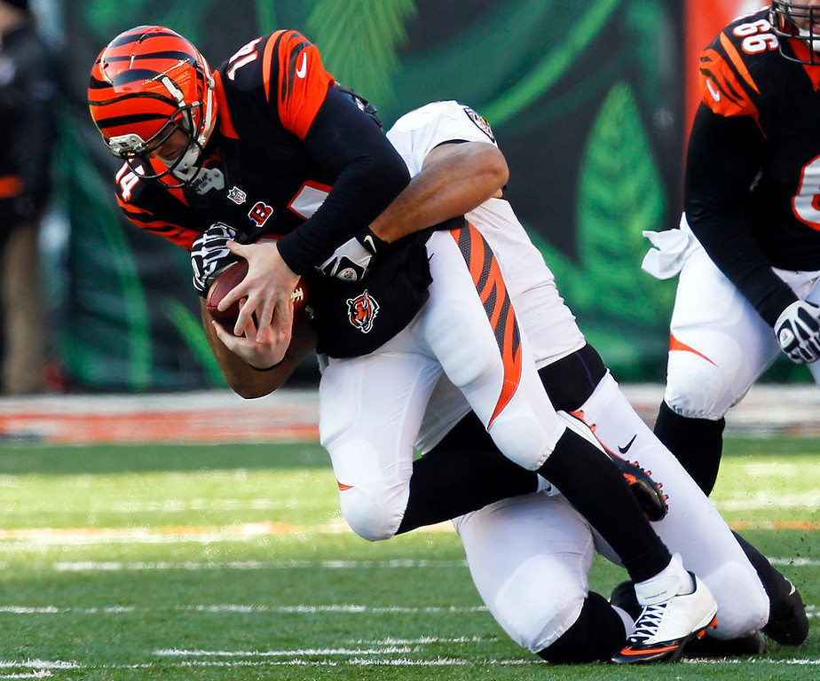 . Cincinnati Bengals quarterback Andy Dalton (14) is sacked by Baltimore Ravens\' Arthur Jones during the first half of play in their NFL football game at Paul Brown Stadium in Cincinnati, Ohio, December 30, 2012.      REUTERS/John Sommers II