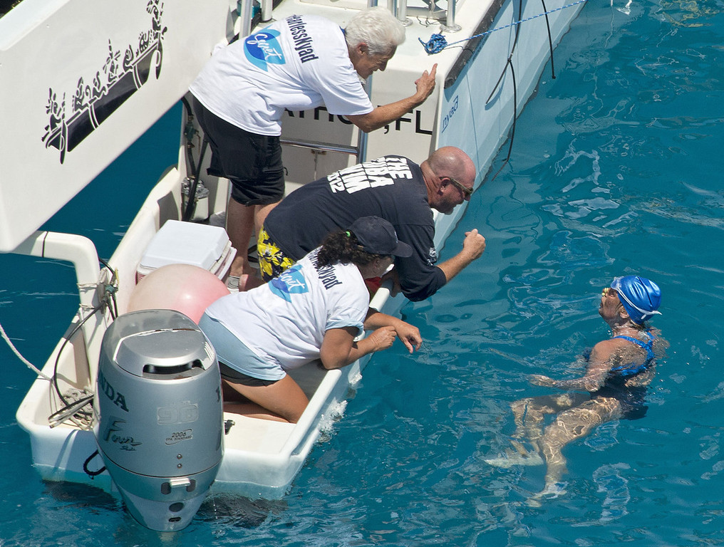 . Swimmer Diana Nyad talks with her crew less than two miles off Key West, Fla., Monday, Sept. 2, 2013. Nyad, 64, is the first swimmer to cross the Florida Straits from Cuba to the Florida Keys without the security of a shark cage. (AP Photo/Florida Keys News Bureau, Andy Newman)