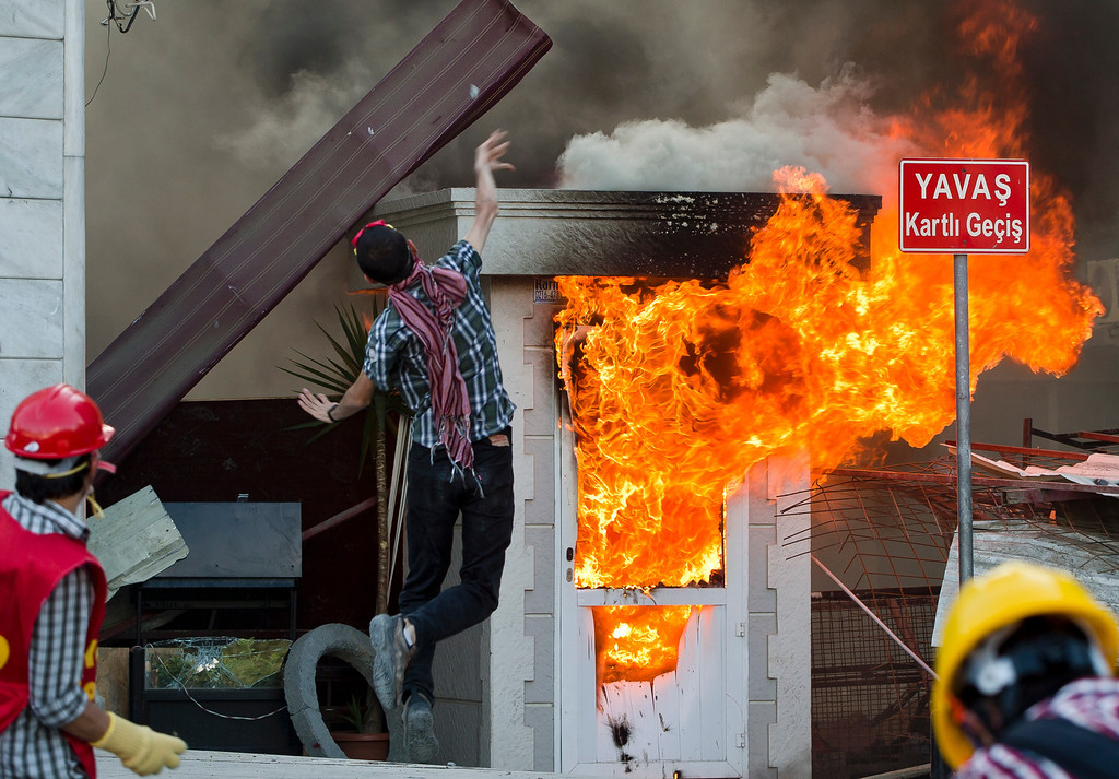 . A protester throws a stone during clashes at the Taksim Square in Istanbul Tuesday, June 11, 2013. (AP Photo/Vadim Ghirda)