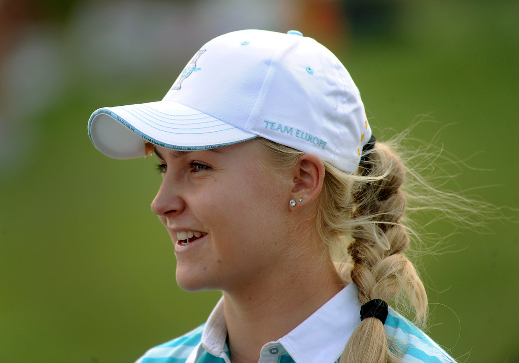 . PARKER, CO. - AUGUST 17: English golfer Charley Hull smiled on the 18th green Saturday at the Solheim Cup. It was the American Team versus the Europeans as play continued at the Colorado Golf Club Saturday afternoon, August 17, 2013. Photo By Karl Gehring/The Denver Post