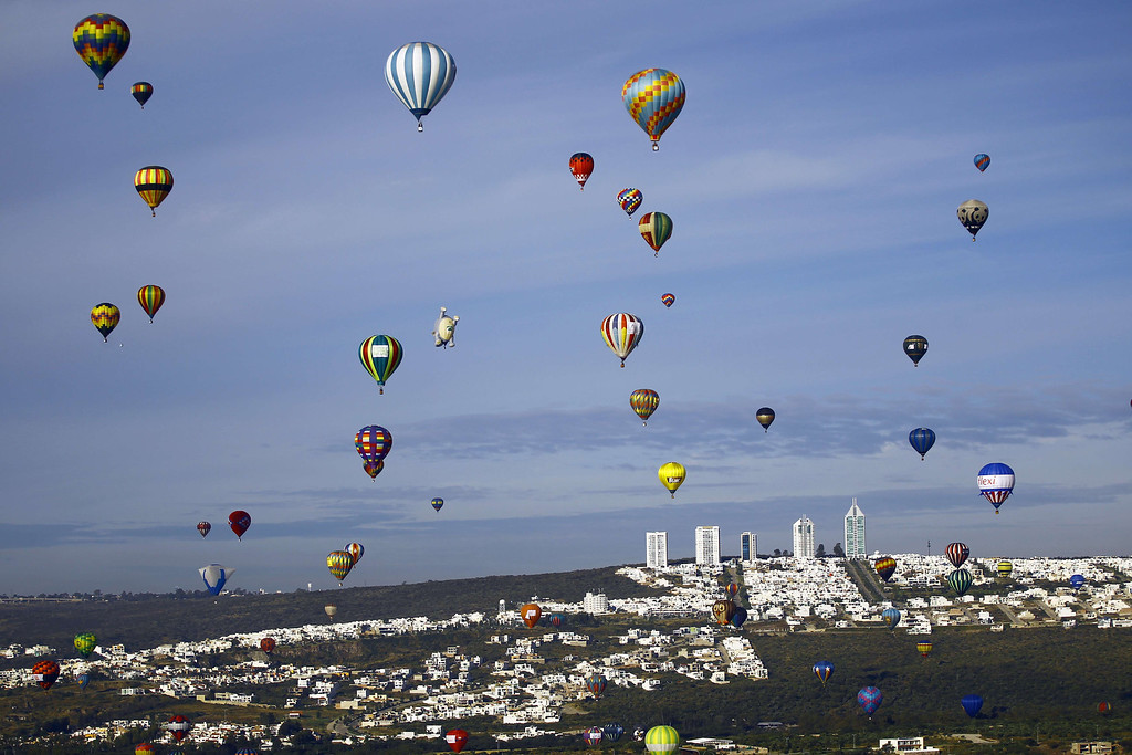 . Hot air balloons fly during the International Balloon Festival at the Metropolitan Park in Leon, Guanajuato state, Mexico on November  15, 2013. Around 200 baloonists from 16 different countries take part in the festival.  AFP PHOTO/Hector GUERRERO/AFP/Getty Images