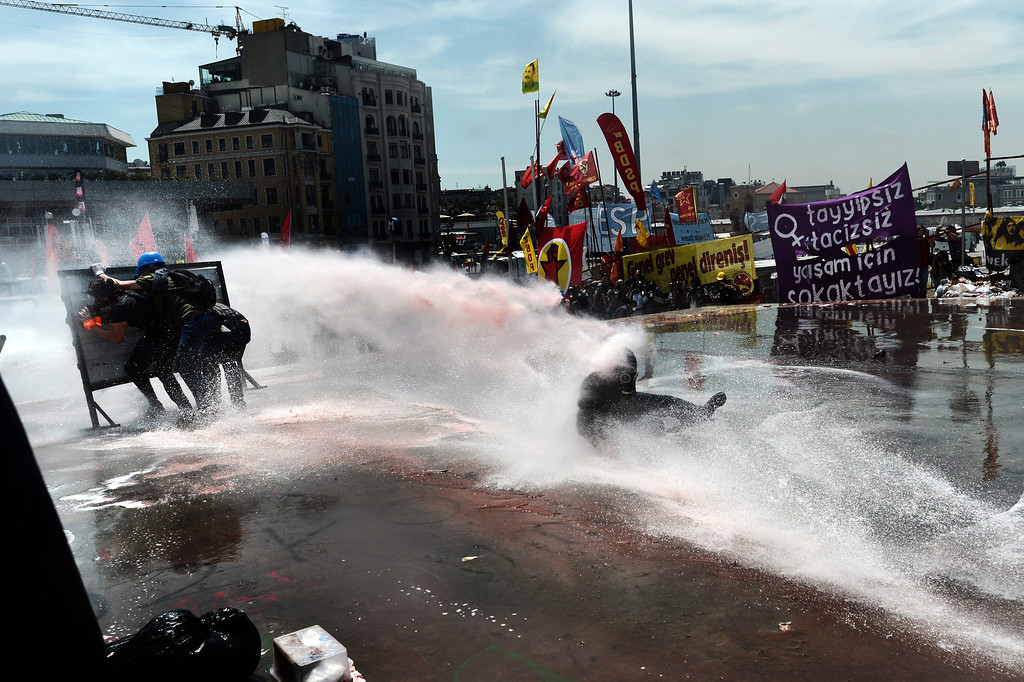 . A protester is hit by a water cannon during clashes with riot police in Taksim square in Istanbul on June 11, 2013. AFP PHOTO / ARIS MESSINIS/AFP/Getty Images