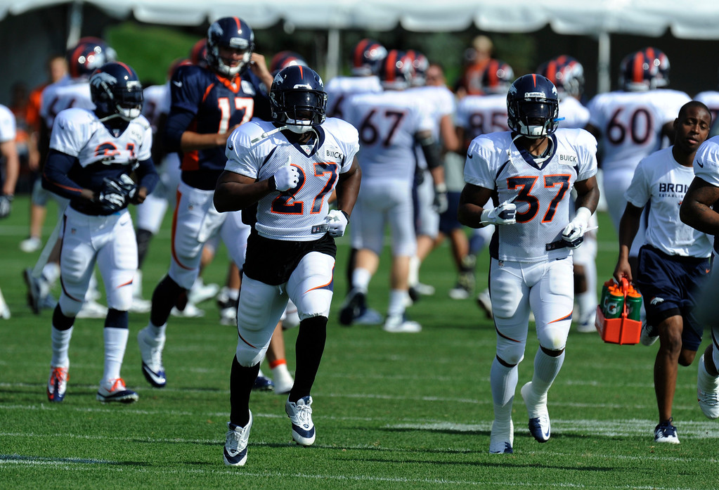 . ENGLEWOOD, CO - JULY 27: Denver Broncos RB, Knowshon Moreno, left, and RB, Jeremiah Johnson, right, head off for a running drill during training camp at Dove Valley Saturday July 26, 2013.  (Photo By Andy Cross/The Denver Post)