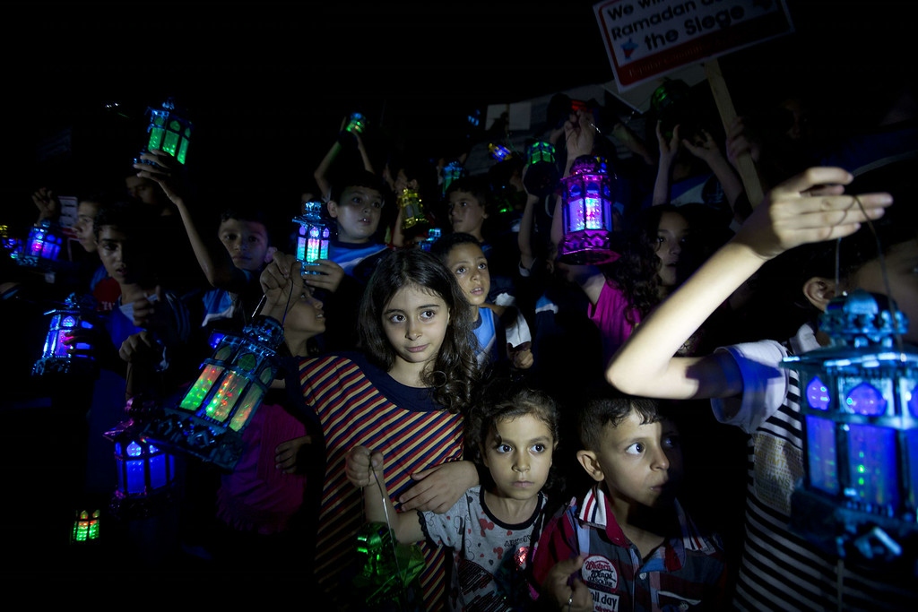 . Palestinian children carry traditional Ramadan lanterns in Gaza city, on June 28, 2014, during a demo against the seige on the Gaza strip, a day before the beginning of the Muslim holy month of Ramadan. MAHMUD HAMS/AFP/Getty Images