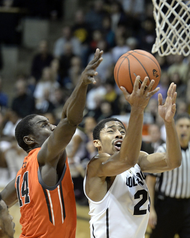 . Colorado\'s Spencer Dinwiddie drives to the basket past Oregon State\'s Eric Moreland during an NCAA college basketball game Thursday, Jan. 2, 2014, in Boulder, Colo. Jeremy Papasso/Daily Camera