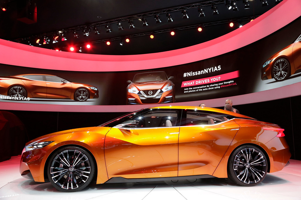 . Members of the media view the Nissan Sports Sedan Concept at the New York International Auto Show, Wednesday, April 16, 2014, in New York. (AP Photo/Mark Lennihan)