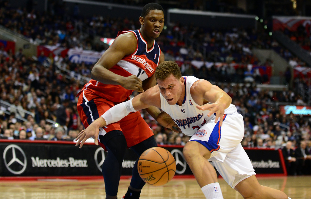 . Blake Griffin of the Los Angeles Clippers (R) vies for the ball with Kevin Seraphin of the Washington Wizards (#42) during their NBA game in Los Angeles on January 19, 2013.  FREDERIC J. BROWN/AFP/Getty Images