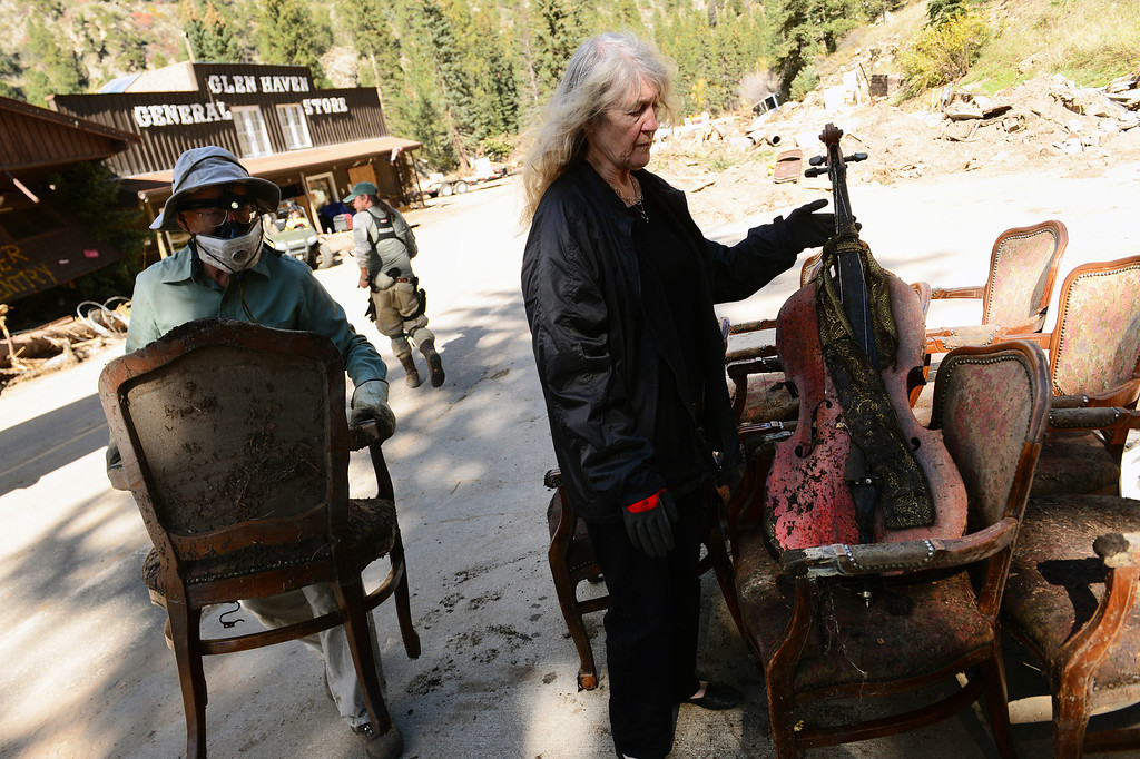 . GLEN HAVEN, CO - OCTOBER 8: Glen Haven Inn owner Sheila Sellers looks at what remains of some of the thousands of antiques that filled the inside of her historic Glen Haven Inn in Glen Haven, CO on October 8, 2013.  The Inn was one of the only businesses that actually made it in the town but has been inundated with mud and debris.  (Photo By Helen H. Richardson/ The Denver Post)