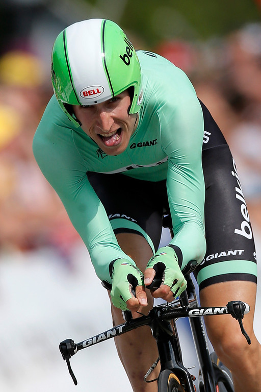 . Bauke Mollema of The Netherlands, who tumbled from second to fourth place in the overall standings, strains in the last meters of the seventeenth stage of the Tour de France cycling race an individual time trial over 32 kilometers (20 miles) with start in Embrun and finish in Chorges, France, Wednesday July 17, 2013. (AP Photo/Laurent Rebours)