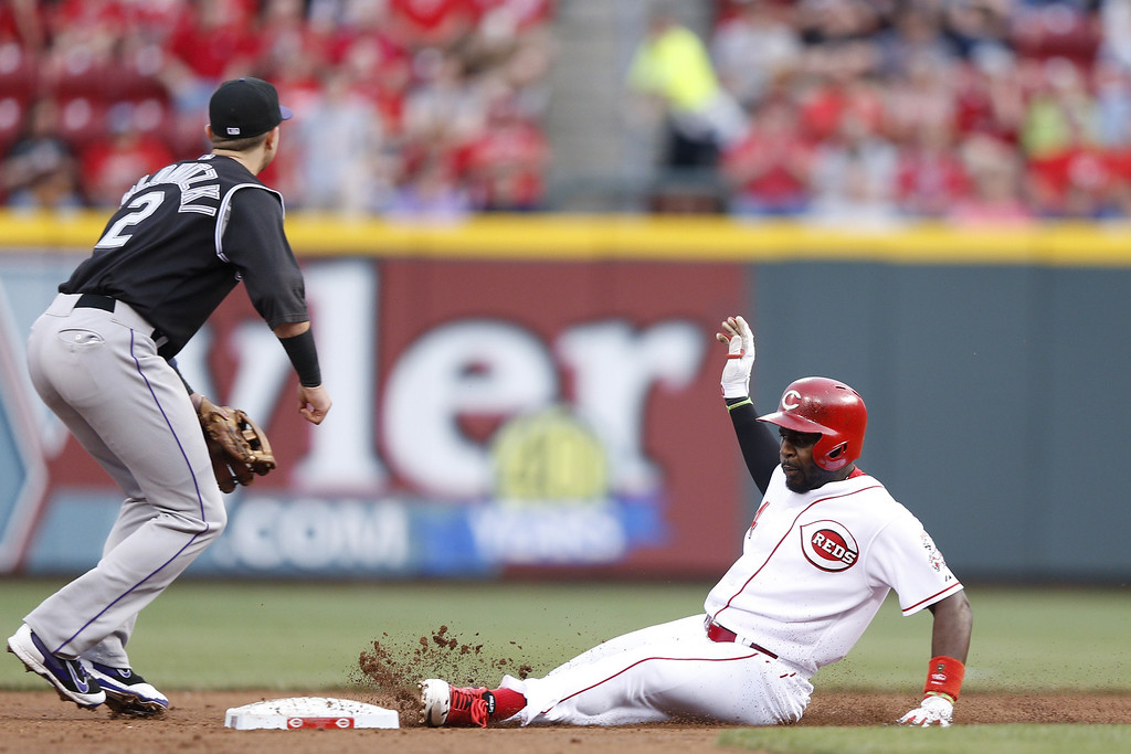 . CINCINNATI, OH - MAY 9:  Brandon Phillips #4 of the Cincinnati Reds slides into second base with a double in the third inning of the game against the Colorado Rockies at Great American Ball Park on May 9, 2014 in Cincinnati, Ohio. (Photo by Joe Robbins/Getty Images)