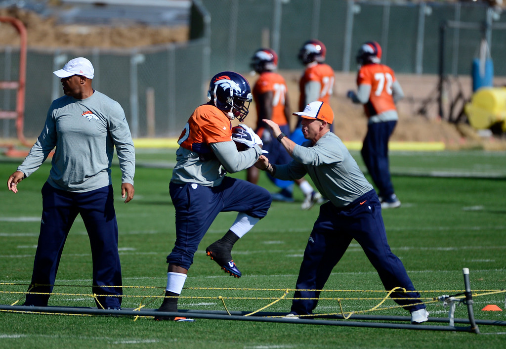 . C.J. Anderson (22) runs through drill with the rest of the rest of the running backs during practice. The Denver Broncos practice at Dove Valley on Monday, Sept. 1, 2014 in preparation for their season opener against the Indianapolis Colts on Sunday night. (Kathryn Scott Osler/The Denver Post)