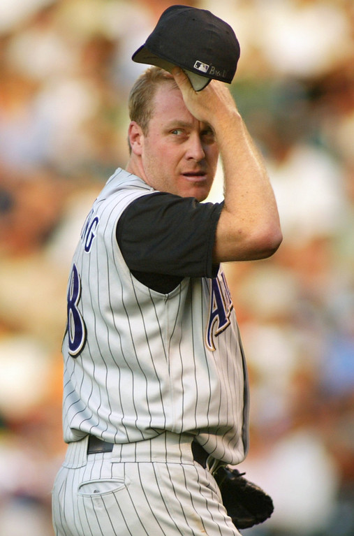 . CURT SCHILLING -- Arizona Diamondbacks starting pitcher Curt Schilling looks to third where Colorado Rockies\' Larry Walker stopped on a Todd Helton double during the first inning at Coors Field in Denver on July 17, 2002. (AP Photo/Jack Dempsey)