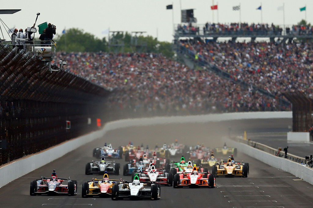 . Ed Carpenter, driver of the #20 Fuzzy\'s Vodka / Ed Carpenter Racing Chevrolet, leads the field at the start of the IZOD IndyCar Series 97th running of the Indianpolis 500 mile race at the Indianapolis Motor Speedway on May 26, 2013 in Indianapolis, Indiana.  (Photo by Chris Graythen/Getty Images)