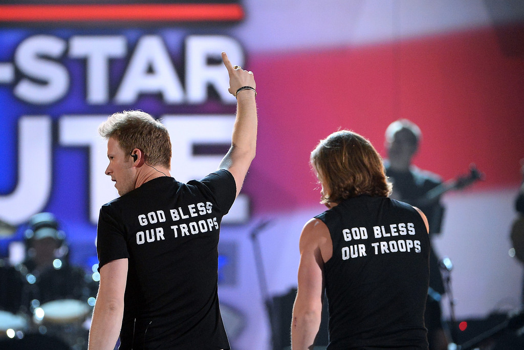 . Singers Brian Kelley (L) and Tyler Hubbard of Florida Georgia Line perform onstage during ACM Presents: An All-Star Salute To The Troops at the MGM Grand Garden Arena on April 7, 2014 in Las Vegas, Nevada.  (Photo by Ethan Miller/Getty Images for ACM)